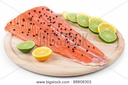 Raw salmon fillet on platter.