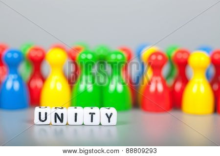 Cube Letters Show Unity  In Front Of Unsharp Figures