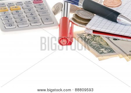 Closeup of calculator, marker, banknotes, coins and paper