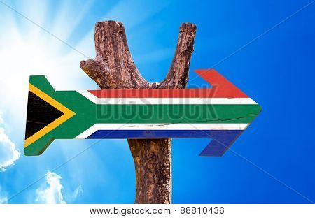 South Africa Flag wooden sign with sky background