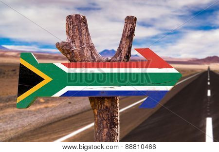 South Africa Flag wooden sign with desertic road background