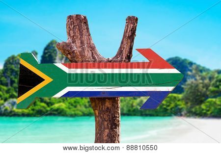 South Africa Flag wooden sign with beach background