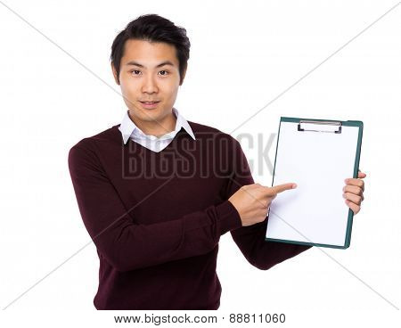 Asian young man finger point to blank page of clipboard
