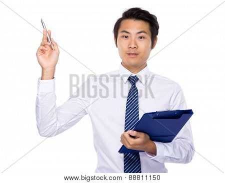 Young businessman hold with clipboard and pen point up