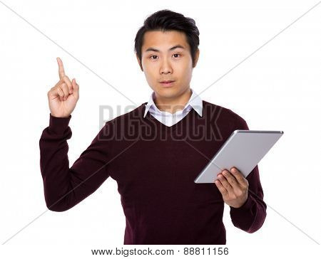 Asian businessman look at digital tablet and finger point up
