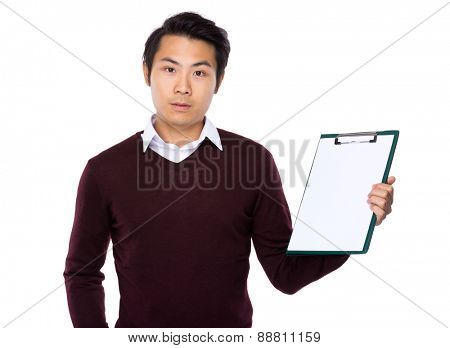 Asian young man show with blank page of clipboard