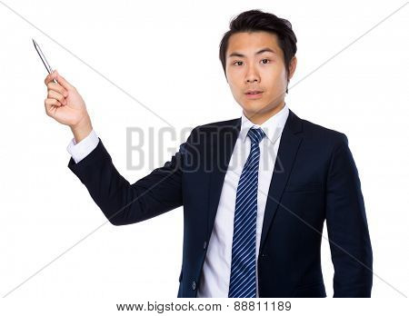 Asian businessman with pen pointing up