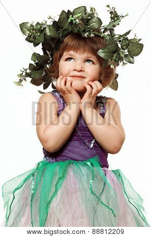Little Girl In A Beautiful Dress With A Wreath On His Head