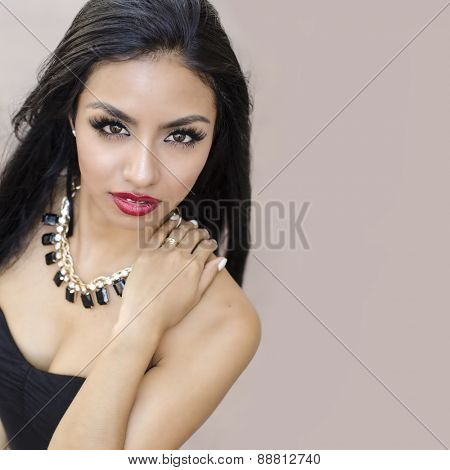Beautiful young woman long dark hair in black dress