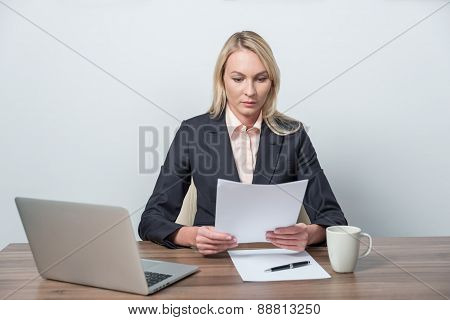 Young Beautiful Businesswoman Is Reviewing Legal Documents.