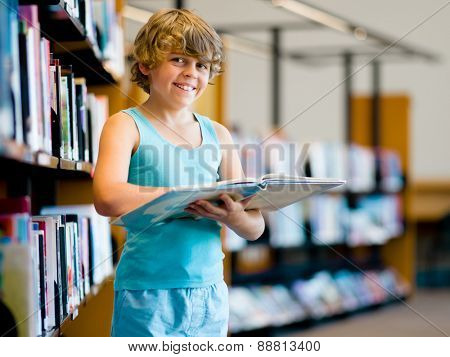 Boy in library choosing books