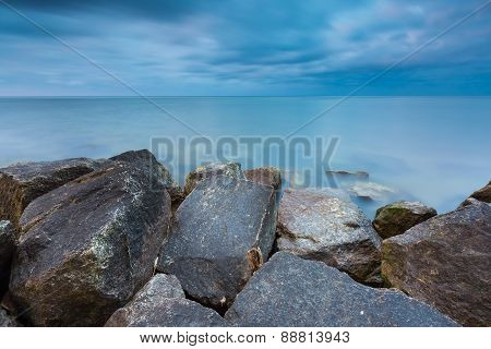 Beautiful Baltic Sea Landscape With Stone Breakwater.