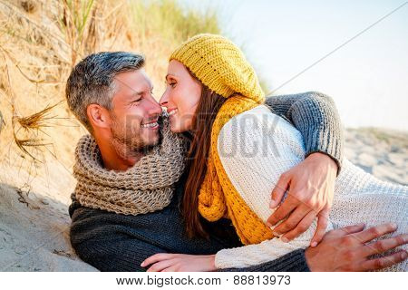 smiling embracing funny loved girlfriend with boyfriend