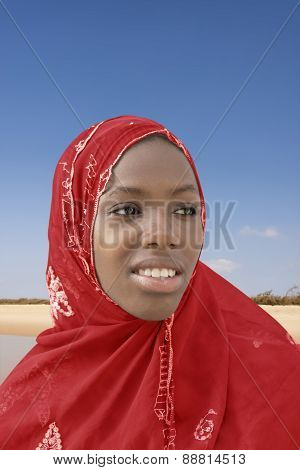 Young Afro beauty wearing a red headscarf