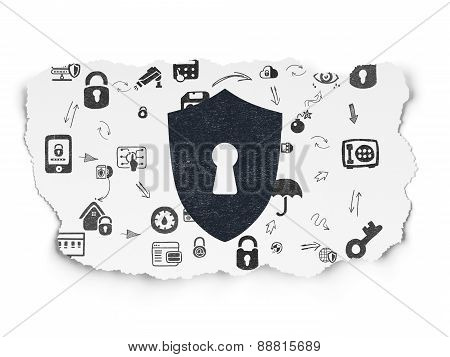 Safety concept: Shield With Keyhole on Torn Paper background