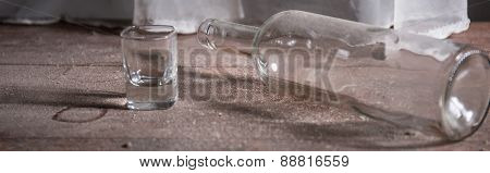 Close-up Of Empty Bottle And Glass