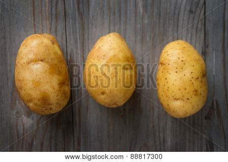 Fresh Potato on Wooden Table Background, Concept and Idea of Food Cook Rustic Still life Style. Dramatic light table setting.