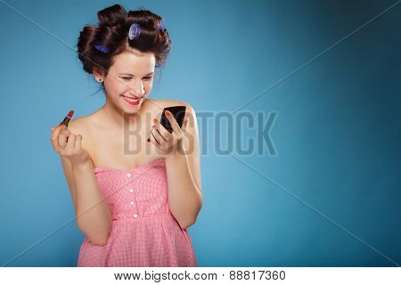 Girl In Hair Curlers Applying Red Lipstick