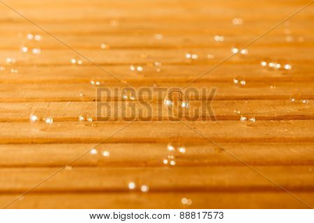 Soap Bubbles On Wooden Background