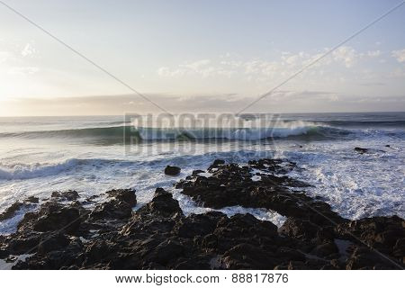 Wave Swells Rocky Coastline