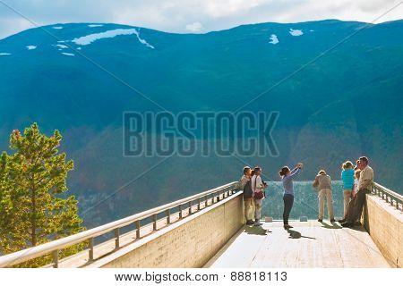 Tourists On Stegastein Viewpoint Aurland, Sogn Og Fjordane, Norway