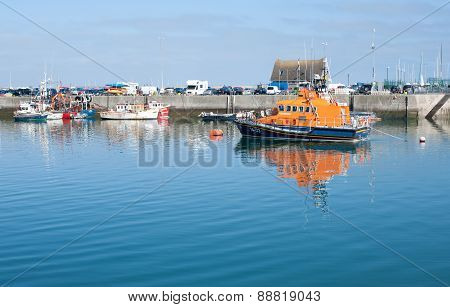 Calm Howth Harbour Scene View With Lifeboat