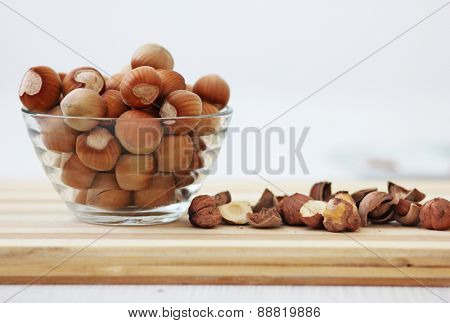 Nuts in bowl and on table