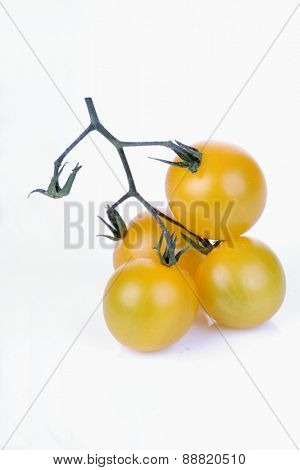 Studio shot of yellow cherry tomatoes
