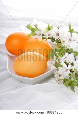 Orange easter eggs in in bowl