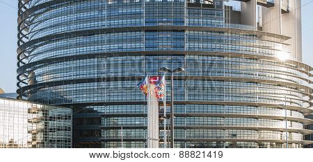 Frontal View Of The European Parliament Building In Strasbourg, France With Flags Waving On A Spring