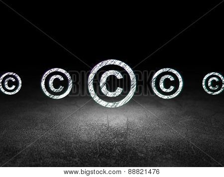Law concept: copyright icon in grunge dark room