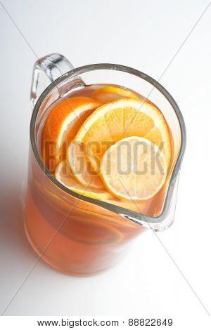 Close up of jug with orange juice - studio shot