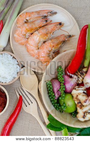 Spices In Bowl And Prawn On Sackcloth Background