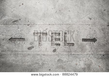 Telecommunication Sign On Cement Floor