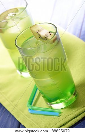 Glass of kiwi juice with ice
