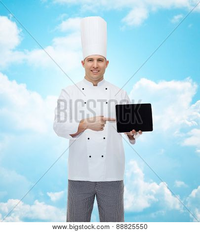 cooking, profession and people concept - happy male chef cook showing tablet pc computer black blank screen over blue sky with clouds background