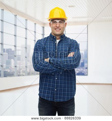 repair, construction, building, people and maintenance concept - smiling male builder or manual worker in helmet over empty flat background