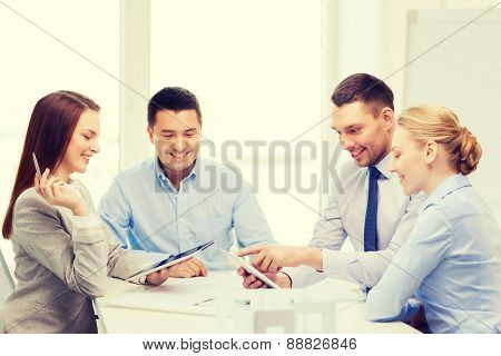 business, technology, architecture and office concept - happy team of architects and designers in office with tablet pc computers