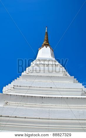 White Pagoda & Buddha Statue On Blue Sky