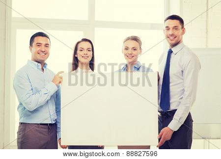 business and office concept - happy business team in office with white blank board