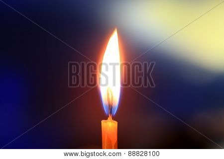 Flame of candle light in darkness