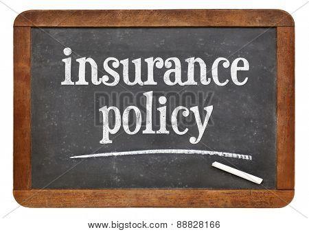 insurance policy text on  a vintage slate blackboard