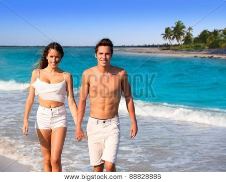 couple young tourists walking in a tropical Caribbean beach in Mexico photo mount