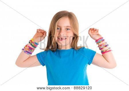 Loom rubber bands bracelets blond kid girl smiling open arms gesture on white background