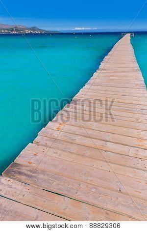 Majorca Platja de Muro beach pier in Alcudia bay in Mallorca Balearic islands of Spain