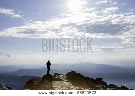 Silhouette Of Man On Top New Hampshire's Mt Washington.
