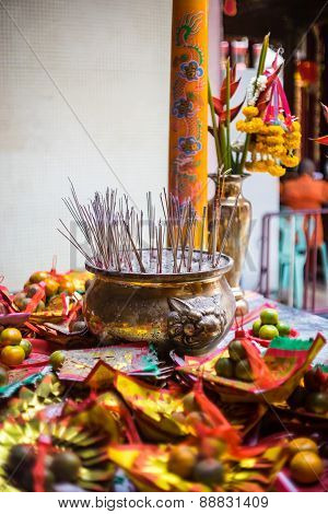 Burning Incense, Incense Paper And Oranges For Offering Chinese God In Chinese Temple