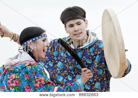 Emotional man dancer dancing with a tambourine. Russia, Kamchatka