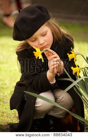 Sad Young Girl In Beret Stroking Daffodil