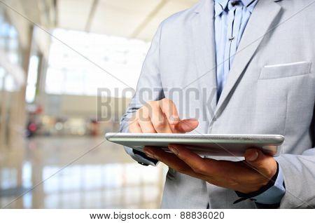 Business Man Using Mobile Digital Tablet In Modern Building.
